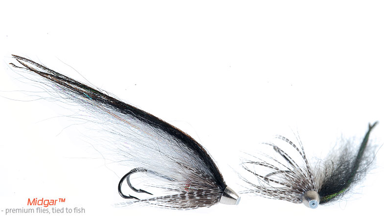 Midgar Silver & Silver is a fly that has proven to work well on overcast days with some rain and some sun. When standing in the river under those weather conditions you just feel that this is the right fly for the next cast. It has a whitish, greyish underwing, topped with a thin black overwing. Delivered in size 48, 60, 69, 75 and 95 mm.